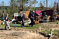 FEMA - 44144 - FEMA and State CR Workers at Damaged Home in MS.jpg