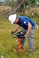 FEMA - 44228 - AmeriCorps Member Drills Holes for Fencing in Mississippi.jpg
