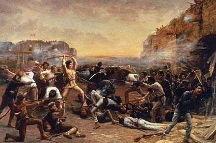 The Fall of the Alamo (1903) by Robert Jenkins Onderdonk, depicts Davy Crockett wielding his rifle as a club against Mexican troops who have breached the walls of the mission. FalloftheAlamo.jpg