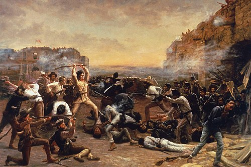 Davy Crockett leading Texian defenders in the Battle of the Alamo which depicted him wielding his rifle as a club against Mexican troops who have breached the walls of the old Spanish mission FalloftheAlamo.jpg