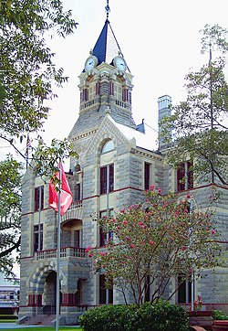 The current Fayette County Courthouse in La Grange was finished in 1891. The Romanesque Revival style building uses four types of native Texas stone to detail the exterior.