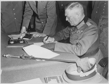 Field Marshall Wilhelm Keitel, signing the ratified surrender terms for the German Army at Russian Headquarters in... - NARA - 531290.tif