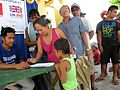 Filipinos affected by Typhoon Haiyan register at an IOM distribution point supported by UK aid (14121060326).jpg