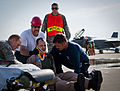 Firefighters and medical technicians with the U.S. Air Force's 96th Test Wing prepare to move a simulated injured F-35 Lightning II aircraft pilot during a major accident response exercise (MARE) at Eglin Air 130509-F-OC707-005.jpg