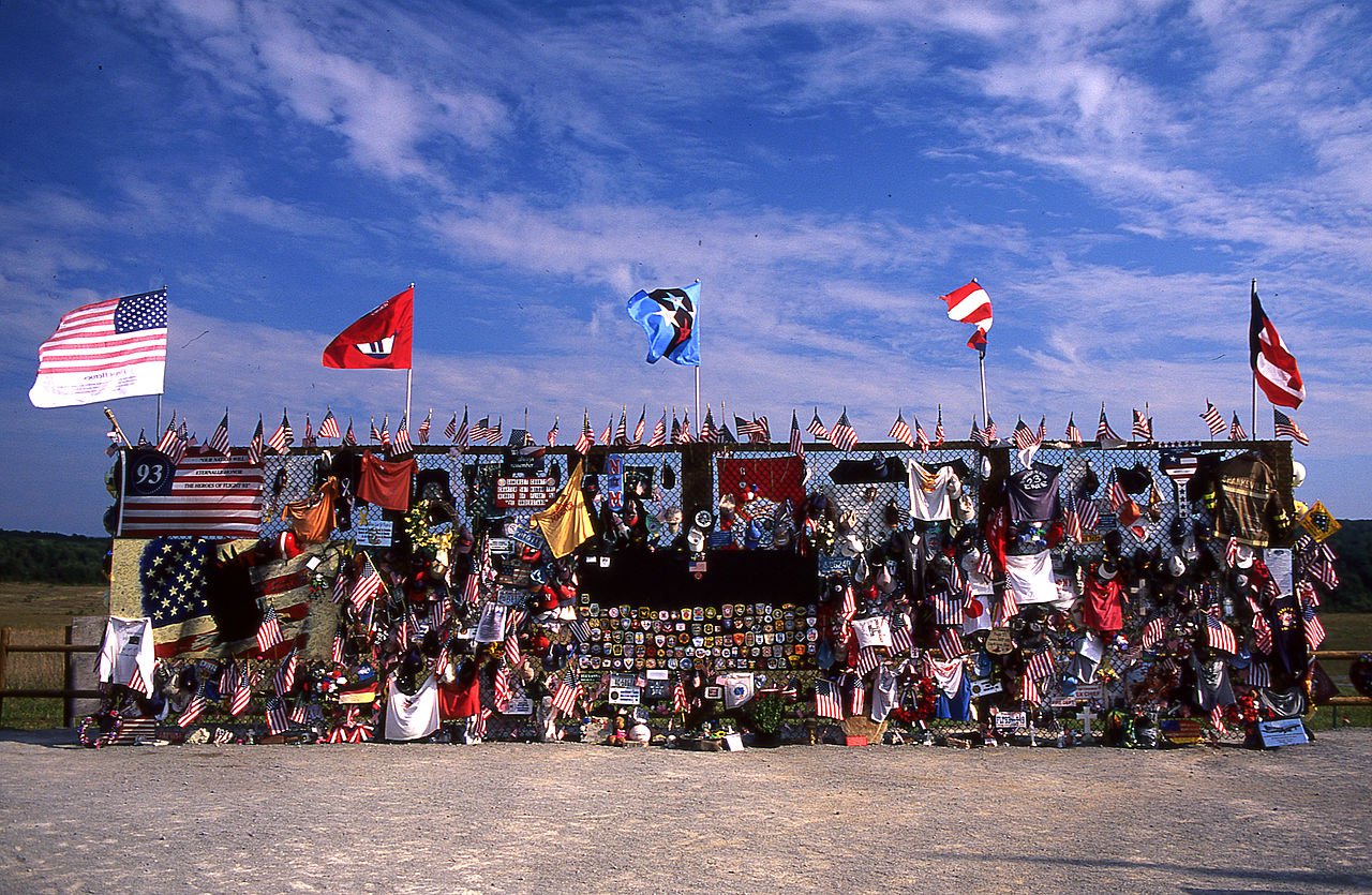 A chainlink fence covered in mementos and flags dedicated to the flight 93 crash
