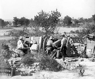 Troupes coloniales - French Colonial 75 mm artillery gun in action near Sedd el Bahr at Cape Helles, Gallipoli, during the Third Battle of Krithia, 4 June 1915.