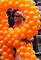 Gay pride - Face in orange baloons (14555150503).jpg