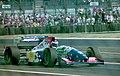 Gianni Morbidelli - Footwork FA15 leaves the pits at the 1994 British Grand Prix (32388854942).jpg