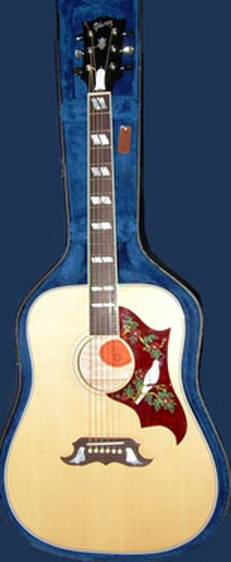 Pickguard - A Gibson Dove acoustic guitar, with an ornately-decorated tortoiseshell pickguard.