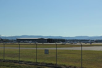 Glacier Park International Airport - Airplanes and hangars from U.S. Route 2