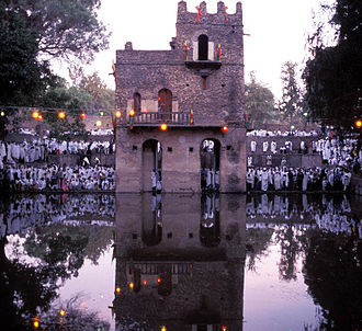 Amhara people - Crowds gather at the Fasilides' Bath in Gondar to celebrate Timkat - the Epiphany for the Ethiopian Orthodox Tewahedo Church.