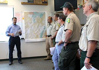 Brian Sandoval - Sandoval meets with the Interagency Fire Management Team during a visit to the Elko Interagency Dispatch Center in Elko on August 12, 2012.