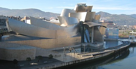 The Guggenheim Museum Bilbao by Frank Gehry, on the Nervión River in downtown Bilbao, Spain.