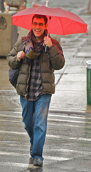 File:Happy man in a rainy day.jpg