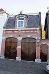 foto van Koetshuis/pakhuis, opgetrokken in eclectische- en neo-renaissancestijl
