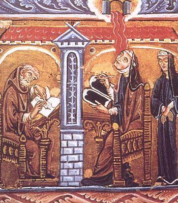 Hildegard reading and writing