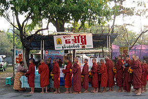 Buddhism in Myanmar - Monks throughout Myanmar make alms rounds around the community in the early morning.