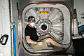 ISS-43 Terry Virts sits is one of the hatchways.jpg