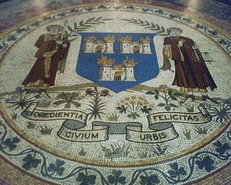 Dublin Corporation - The Coat of Arms and motto of Dublin Corporation, from a floor mosaic in City Hall. The arms underwent numerous revisions but always featured the original 13th-century image of three burning castles on its shield.