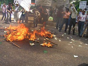 Riaz Ahmed Gohar Shahi - Pakistani adherents of Shahi burning their passports during a protest in India (April 2007).