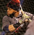 Indians DH Carlos Santana takes batting practice at Wrigley Field. (30343443110).jpg