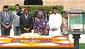Jakaya Kikwete and the First lady of Tanzania, Mrs. Salma Kikwete paying homage at the Samadhi of Mahatma Gandhi, at Rajghat, in Delhi. The Minister of State for Agriculture.jpg