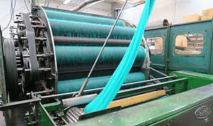 Carding - Dyed wool processed with Tatham (1949) carding machine at Jamieson Mill, Sandness (Shetland).