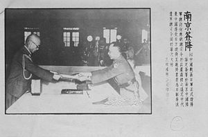 He Yingqin - Commander-in-chief of the China Expeditionary Army Yasuji Okamura presenting the Japanese Instrument of Surrender to He Yingqin in Nanjing on 9 September 1945.