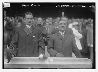 1915 New York Yankees season - John Purroy Mitchel holding his Homburg hat and Jacob Ruppert, Jr. at the opening day Yankee game at the Polo Grounds on April 22, 1915, with Mitchel getting ready to throw out the ceremonial first pitch