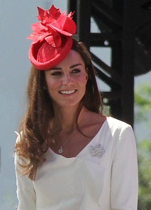 Fascinator - Catherine, Duchess of Cambridge, wearing a red 'hatinator' during her visit to Canada in 2011