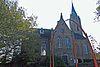 foto van Kerkgebouw op T-vormig grondplan met toren aan de westzijde