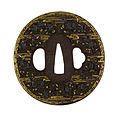 Kitani Masachika - Tsuba with Cherry Blossoms in Mist - Walters 51200.jpg