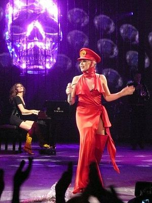 "X (Kylie Minogue album) - Minogue during the act Xposed, performing ""2 Hearts"" on the KylieX2008 tour"