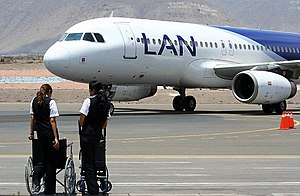 LAN Airlines' A320-200 (CC-COT) and its flight attendants at the Arequipa Airport.