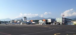 Ljubljana Airport with mountains and Adria Airways planes 2015.jpg