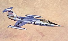 XF-104 prototype in flight over desert