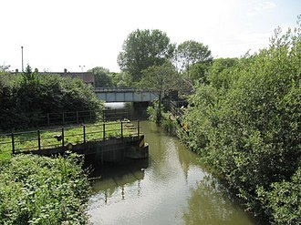 Sheepwash Channel - View of Sheepwash Channel, with the site of the old Rewley Road Swing Bridge in the foreground and the newer Sheepwash Channel Railway Bridge in the background.