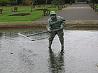 Statue of a recreational shrimper with a push net