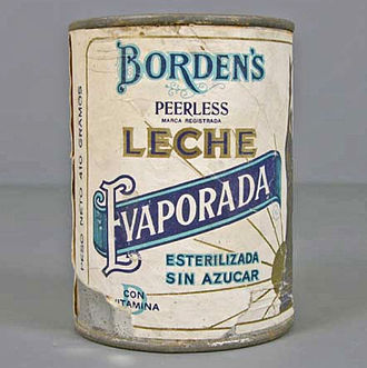Borden (company) - A can of Borden's Peerless brand evaporated milk with label in Spanish, from the second half of the 20th century