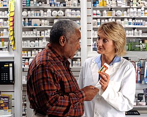 Man consults with pharmacist (2).jpg