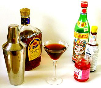 Manhattan (cocktail) - A classic 2:1 Manhattan, made with Canadian whisky, sweet vermouth, bitters, and a cherry
