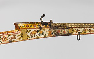 A Rajasthani Toradar with paintings of flowers. Matchlock Gun MET DP216838.jpg