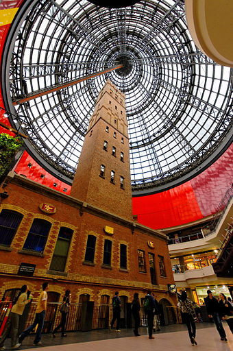 The 19th-century Coop's Shot Tower enclosed in Melbourne Central, one of the city's major retail hubs Melbourne Central Coops Shot Tower.jpg
