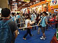 Mighty Media booth visitors running in Comic Exhibition 20140810.jpg