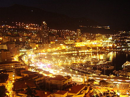 Monaco in Southern Europe, currently holds the record for being the most densely populated nation in the world. Monaco by night.JPG
