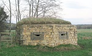 Pillbox (military) - A World War II hexagonal pillbox – on the bank of the Mells River at Lullington, Somerset, England.