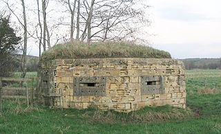 Pillbox (military) concrete dug-in guard posts, normally equipped with loopholes through which to fire weapons