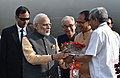 Narendra Modi being received by the Governor of Gujarat and Madhya Pradesh, Shri O.P. Kohli, the Chief Minister of Madhya Pradesh, Shri Shivraj Singh Chouhan and the Union Minister for Defence, Shri Manohar Parrikar (2).jpg