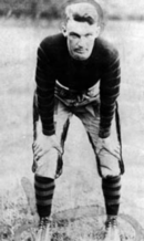 Player in uniform, hands on knees