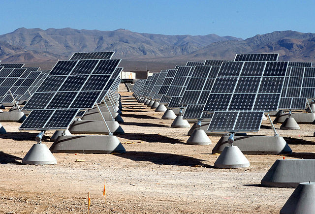 Clinton would greatly expand the use of renewable power by the military. Solar array at Nellis Air Force Base in Nevada.  Courtesy U.S. Air Force. By Senior Airman Larry E. Reid Jr.